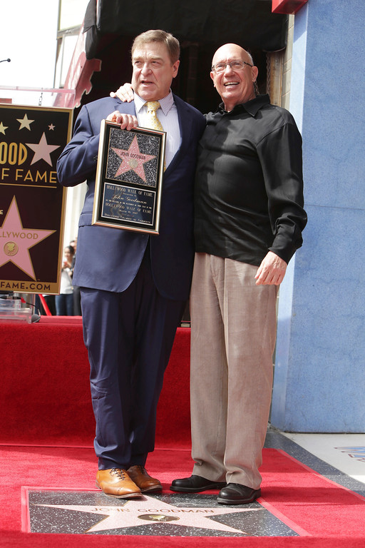 . John Goodman and Dann Florek seen at ceremony honoring John Goodman with a star on the Hollywood Walk of Fame on Friday, March 10, 2017, in Los Angeles. (Photo by Eric Charbonneau/Invision for Warner Bros./AP Images)