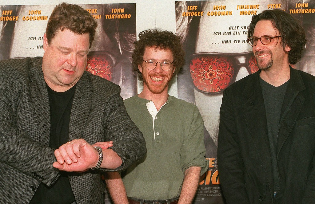 """. File - American actor John Goodman, left, counts the seconds until the end of a photoshooting during the press conference for the American production \""""The Big Lebowski\""""  which is directed of Joel Coen, right, and screenplay writer Ethan Coen, center, at the 48th International Film Festival in Berlin,  February 15, 1998. Three other movies featuring Goodman have already been released this year: \""""Fallen,\"""" \""""Blues Brothers 2000\"""" and \""""The Borrowers.\""""(AP Photo/Hans Edinger)"""