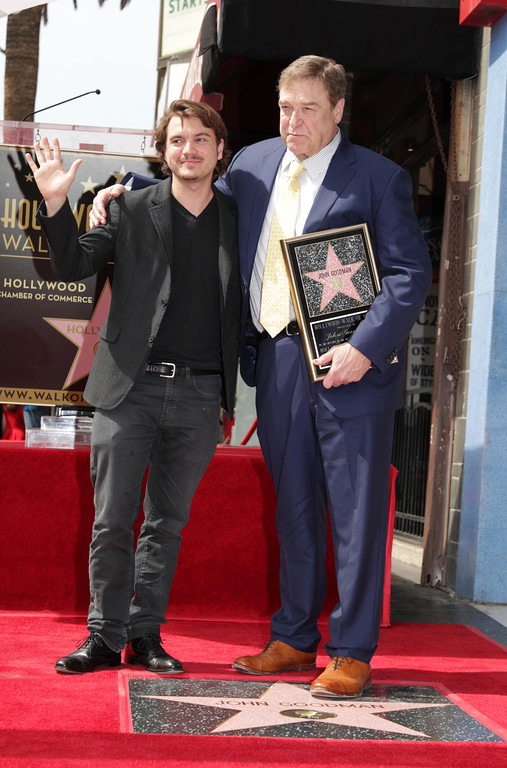 . Emile Hirsch and John Goodman seen at ceremony honoring John Goodman with a star on the Hollywood Walk of Fame on Friday, March 10, 2017, in Los Angeles. (Photo by Eric Charbonneau/Invision for Warner Bros./AP Images)
