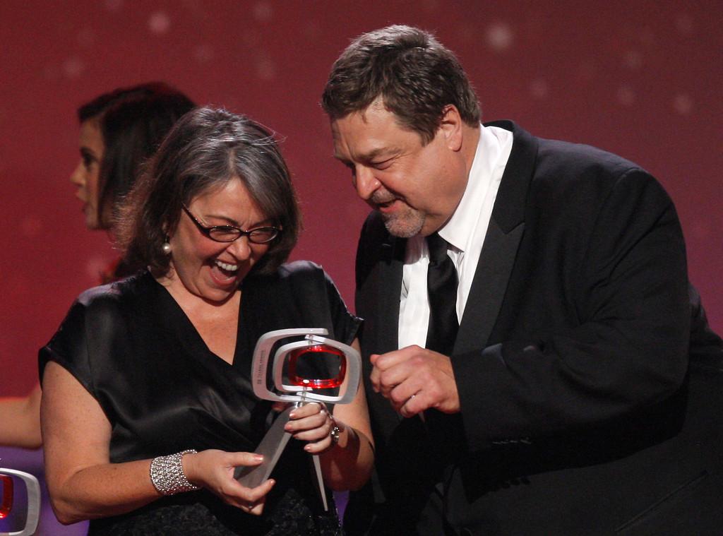 . Roseanne Barr, left, and John Goodman, of the cast of Roseanne, accept the innovation award at the TV Land Awards on Sunday June 8, 2008 in Santa Monica, Calif.   (AP Photo/Kevork Djansezian)