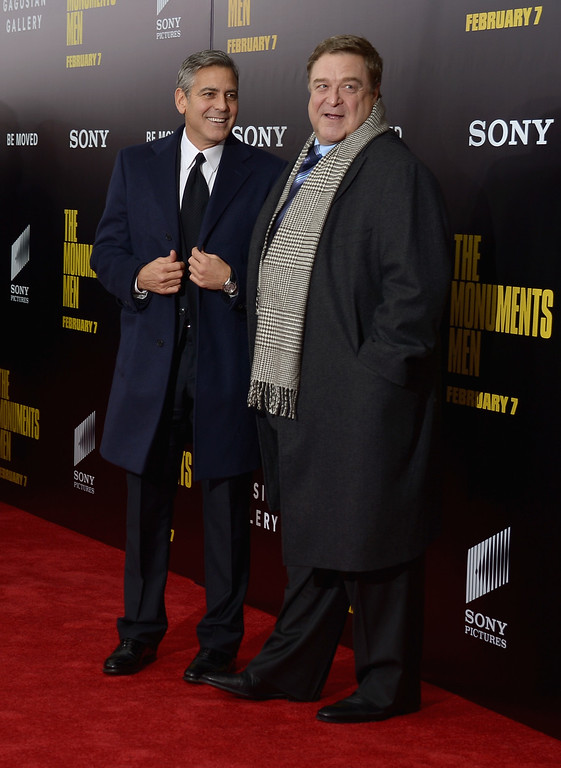 """. NEW YORK, NY - FEBRUARY 04:  Filmmaker George Clooney (L) and actor John Goodman attend \""""The Monuments Men\"""" premiere at Ziegfeld Theater on February 4, 2014 in New York City, New York.  (Photo by Michael Loccisano/Getty Images)"""