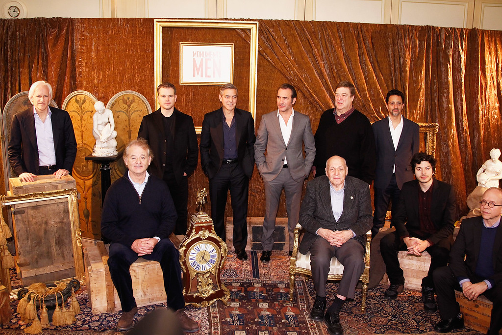 . PARIS, FRANCE - FEBRUARY 12:  (L-R) Writer Robert M. Edsel, actors Bill Murray, Matt Damon, George Clooney, Jean Dujardin, \'Real Monument Man\' Harry Hettlinger, actor John Goodman, producer Grant Heslov, actors Dimitri Leonidas and Bob Balaban attend the \'Monuments Men\' : Photocall at Hotel Le Bristol on February 12, 2014 in Paris, France.  (Photo by Julien M. Hekimian/Getty Images)