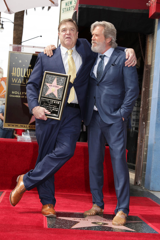 . John Goodman and Jeff Bridges seen at ceremony honoring John Goodman with a star on the Hollywood Walk of Fame on Friday, March 10, 2017, in Los Angeles. (Photo by Eric Charbonneau/Invision for Warner Bros./AP Images)