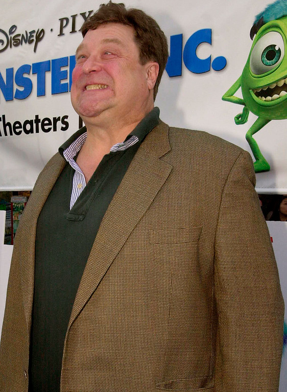 """. Actor John Goodman makes his best monster face before the premiere of \""""Monsters, Inc.\"""" Sunday, Oct. 28, 2001, in the Hollywood area of Los Angeles. Goodman is the voice of \""""James P. Sullivan,\"""" the big blue monster in the animated film. (AP Photo/Kim D. Johnson)"""