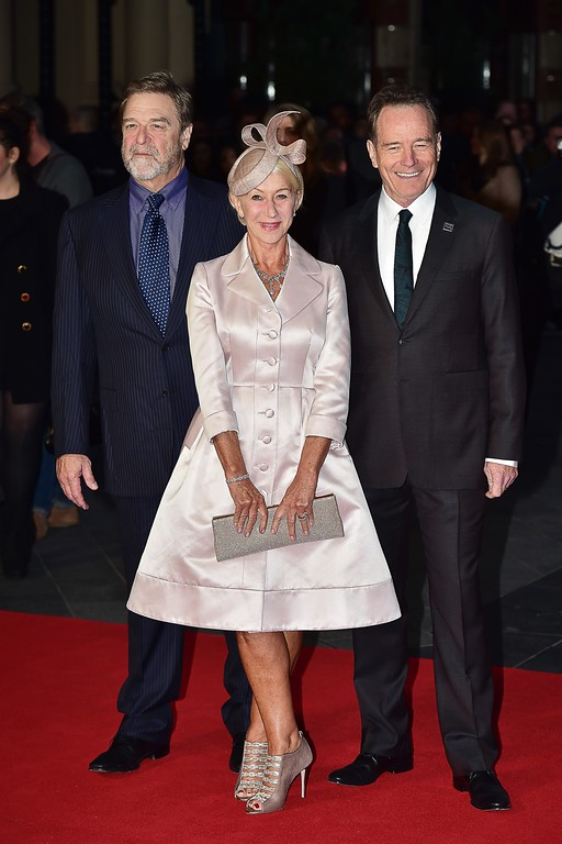 ". (From L) US actor John Goodman, British actress Helen Mirren and US actor Bryan Cranston pose for photographers as they arrive for the European premiere of the film ""Trumbo\"" during the BFI London Film Festival in Leicester Square in central London on October 8, 2015. (LEON NEAL/AFP/Getty Images)"