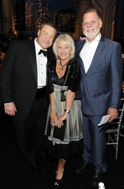 . CULVER CITY, CA - JUNE 10:  (L-R) Actor John Goodman, actress Helen Mirren and husband Director Taylor Hackford in the audience at the 38th AFI Life Achievement Award honoring Mike Nichols held at Sony Pictures Studios on June 10, 2010 in Culver City, California. The AFI Life Achievement Award tribute to Mike Nichols will premiere on TV Land on Saturday, June 25 at 9PM ET/PST.  (Photo by Frazer Harrison/Getty Images for AFI)