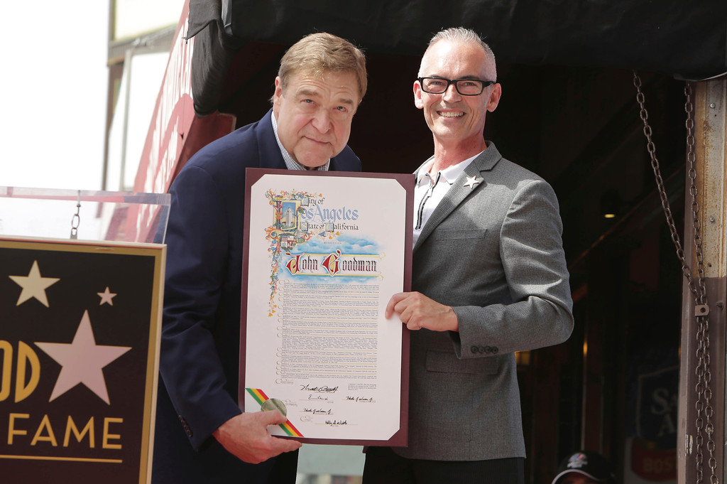 . John Goodman and Los Angeles City Council member Mitch O\'Farrell seen at John Goodman honored with a star on the Hollywood Walk of Fame on Friday, March 10, 2017, in Los Angeles. (Photo by Eric Charbonneau/Invision for Warner Bros./AP Images)