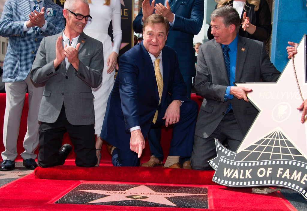 . Actor John Goodman poses on his star on the Hollywood Walk of Fame during his star unveiling ceremony, March 10, 2017, in Hollywood, California.    (ROBYN BECK/AFP/Getty Images)