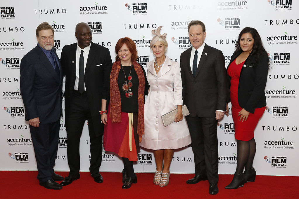 """. LONDON, ENGLAND - OCTOBER 08:  John Goodman, Adewale Akinnuoye-Agbaje, Festival Director Clare Stewart, Helen Mirren and Bryan Cranston attend the \""""Trumbo\"""" Accenture Gala during the BFI London Film Festival at Odeon Leicester Square on October 8, 2015 in London, England.  (Photo by John Phillips/Getty Images for BFI)"""