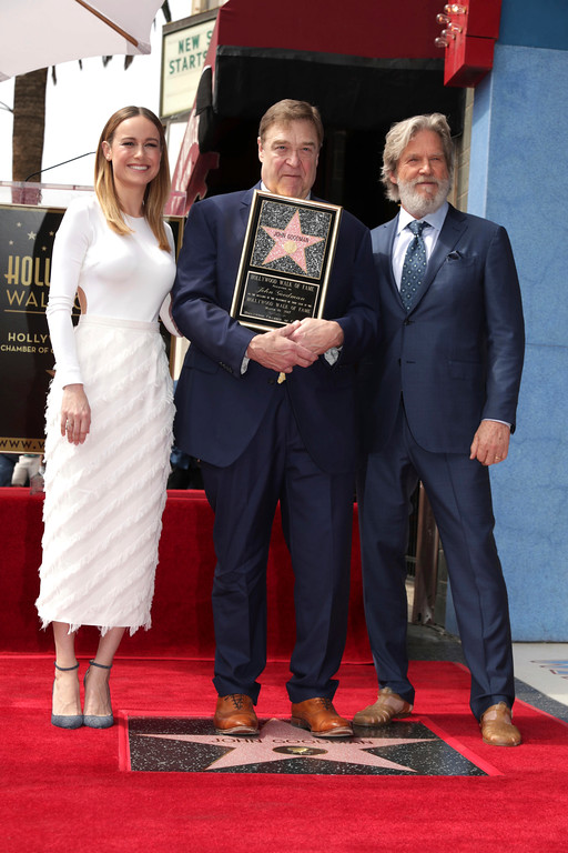 . Brie Larson, John Goodman and Jeff Bridges seen at John Goodman honored with a star on the Hollywood Walk of Fame on Friday, March 10, 2017, in Los Angeles. (Photo by Eric Charbonneau/Invision for Warner Bros./AP Images)
