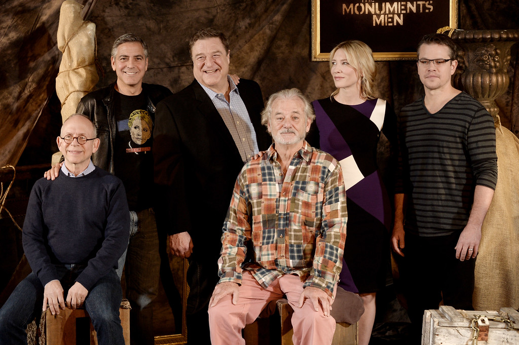 ". LOS ANGELES, CA - JANUARY 16:  (L-R) Actors Bob Balaban, George Clooney, John Goodman, Bill Murray, Cate Blanchett and Matt Damon pose at a photo call for Sony Picture\'s ""The Monuments Men\"" at the Four Seasons Hotel on January 16, 2014 in Los Angeles, California.  (Photo by Kevin Winter/Getty Images)"