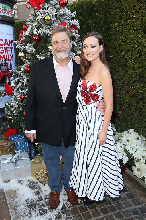 """. LOS ANGELES, CA - NOVEMBER 12:  John Goodman and Olivia Wilde attend the \""""Love The Coopers\"""" Holiday Luncheon Benefiting The LA Regional Food Bank at The Grove on November 12, 2015 in Los Angeles, California.  (Photo by Joe Scarnici/Getty Images for CBS Films)"""