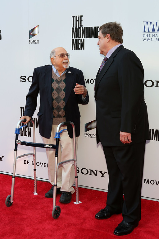 . NEW ORLEANS, LA - JANUARY 23: WWII veteran Tommy Godchaux and actor John Goodman attend The Monuments Men special screening at The Victory Theater at The National WWII Museum on January 23, 2014 in New Orleans, Louisiana. (Photo by Tyler Kaufman/Getty Images for Sony Pictures Entertainment)