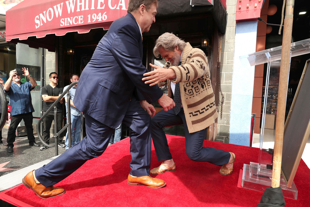 . John Goodman and Jeff Bridges seen at ceremony honoring him with a star on the Hollywood Walk of Fame on Friday, March 10, 2017, in Los Angeles. (Photo by Eric Charbonneau/Invision for Warner Bros./AP Images)