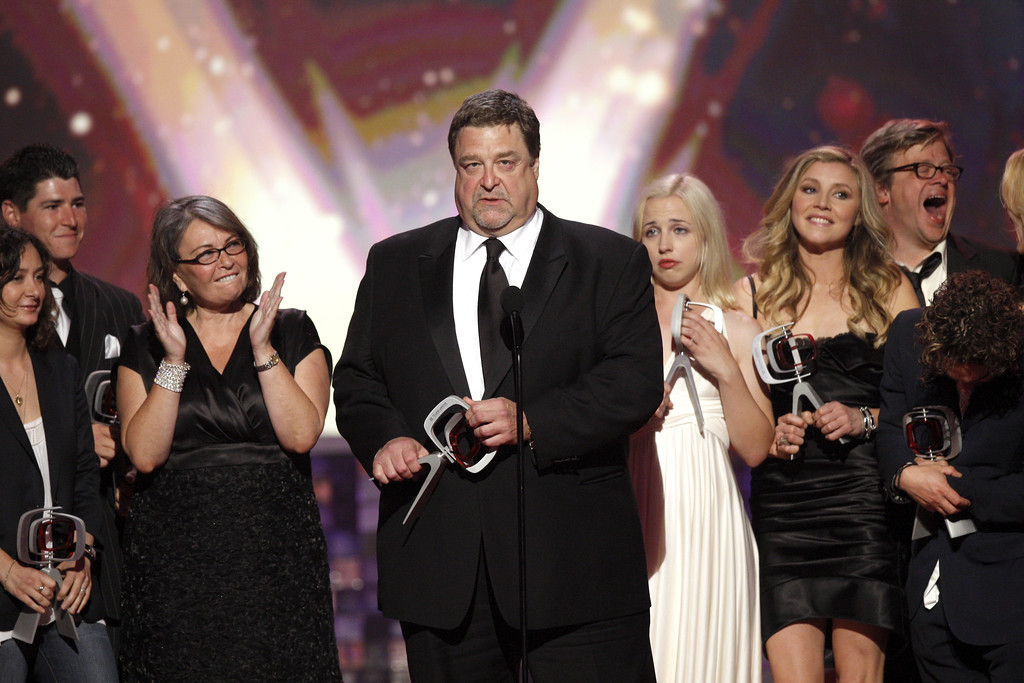 . John Goodman, center, and the cast of Roseanne, accept the innovation award at the TV Land Awards on Sunday June 8, 2008 in Santa Monica, Calif. (AP Photo/Matt Sayles)