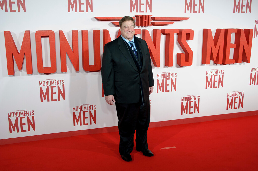 """. John Goodman arrives for the UK Premiere of \""""The Monuments Men\"""" at a central London cinema, London, Tuesday, Feb. 11, 2014. (Photo by Jonathan Short/Invision/AP)"""