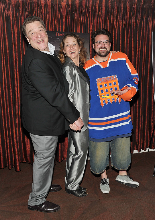 ". NEW YORK, NY - MARCH 05: (L-R) Actors John Goodman, Melissa Leo, and producer/actor Kevin Smith attend ""The Red State\"" tour launch at Radio City Music Hall on March 5, 2011 in New York City.  (Photo by Mike Coppola/Getty Images)"