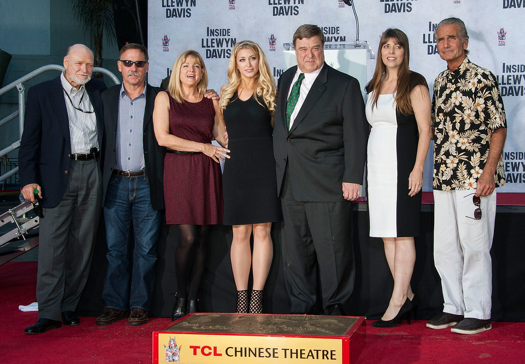 . HOLLYWOOD, CA - NOVEMBER 14:  John Goodman and his family attend the hand and footprint ceremony honoring him at TCL Chinese Theatre on November 14, 2013 in Hollywood, California.  (Photo by Valerie Macon/Getty Images)