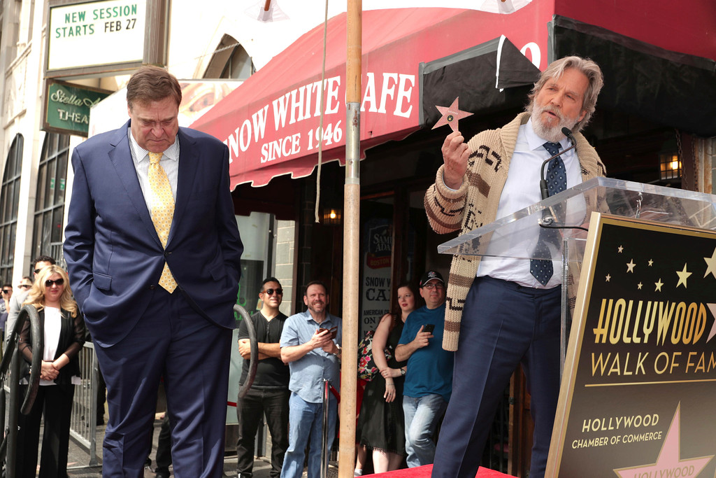 . Jeff Bridges, right, speaks at ceremony honoring John Goodman, left, with a star on the Hollywood Walk of Fame on Friday, March 10, 2017, in Los Angeles. (Photo by Eric Charbonneau/Invision for Warner Bros./AP Images)