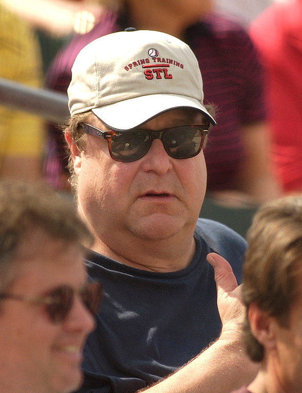. Actor John Goodman watches the St. Louis Cardinals play the Atlanta Braves during a spring training game in Jupiter, Fla., on Sunday, March 9, 2003. (AP Photo/Doug Murray)
