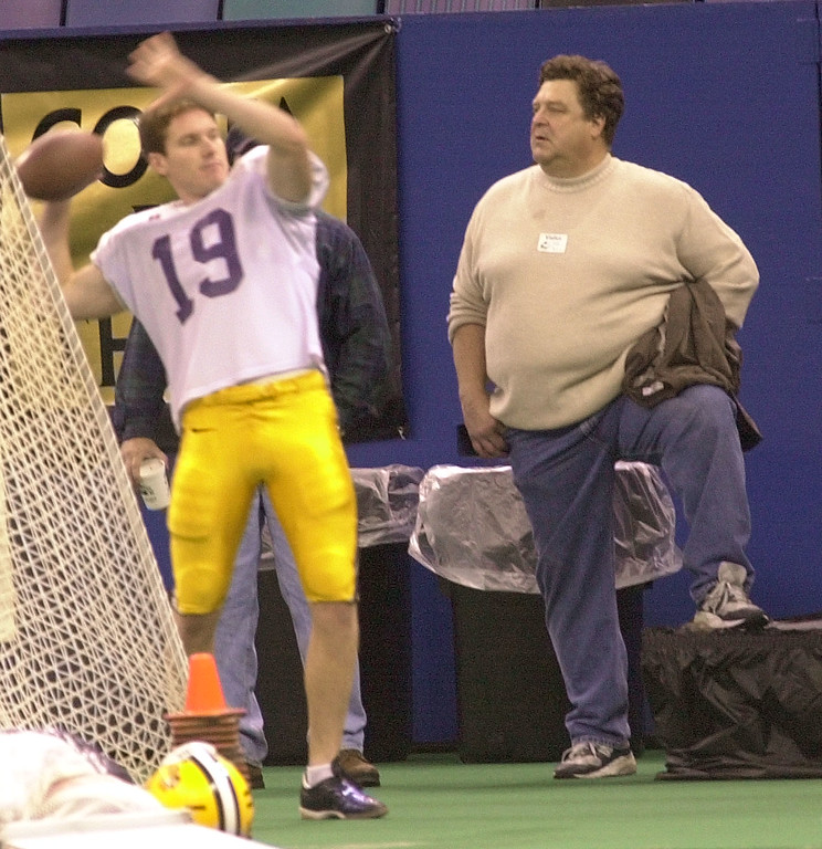 . Actor John Goodman watches the LSU practice in the Louisiana Superdome in New Orleans Friday Dec. 28, 2001. Throwing the ball is Kris Kessler (19). LSU will play the Univeristy of Illinois in the 2002 Sugar Bowl New Year\'s night. (AP Photo/Bill Haber)