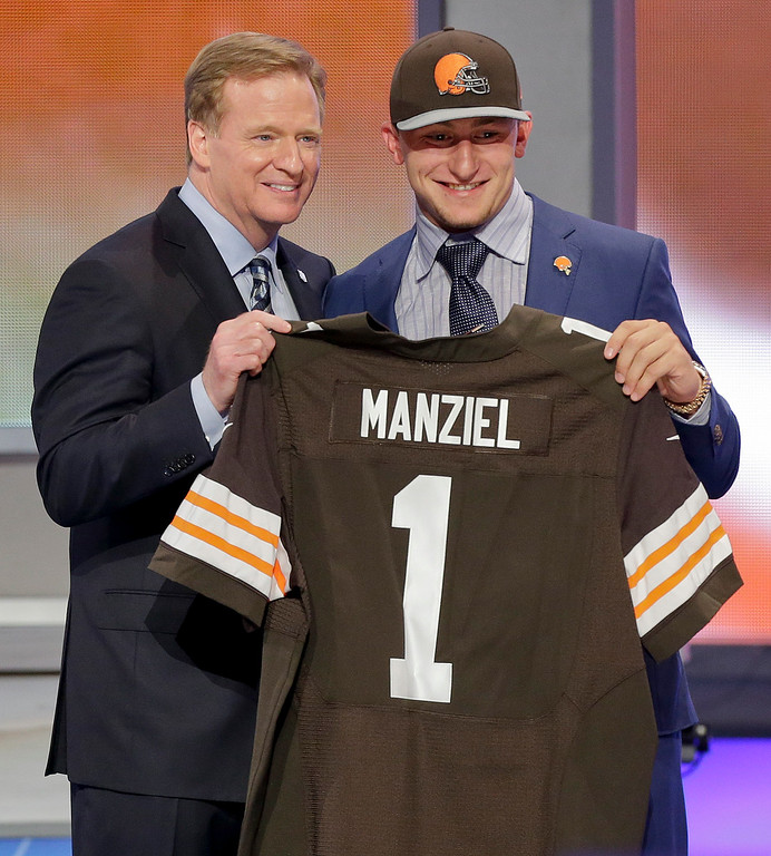 . Texas A&M quarterback Johnny Manziel poses with NFL commissioner Roger Goodell after being selected by the Cleveland Browns as the 22nd pick in the first round of the 2014 NFL Draft, Thursday, May 8, 2014, in New York.  (AP Photo/Frank Franklin II)