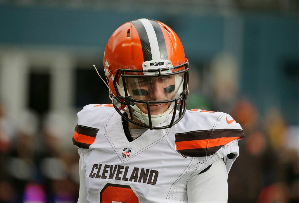 . Cleveland Browns quarterback Johnny Manziel stands on the field during warmups before an NFL football game against the Seattle Seahawks, Sunday, Dec. 20, 2015, in Seattle. The Browns indicated that they�ve finally had enough of Manziel�s bad-boy behavior and intend to release the quarterback in March when the league begins its next calendar year.  (AP Photo/Ted S. Warren)