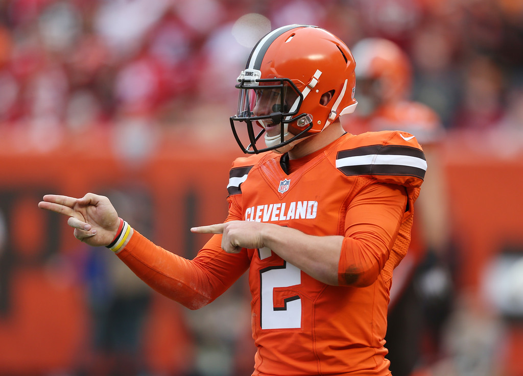 . FILE - In this Dec. 13, 2015, file photo, Cleveland Browns quarterback Johnny Manziel (2) gestures during the first half of an NFL game against the San Francisco 49ers, in Cleveland. Russell Wilson has it all put together. Johnny Manziel has been nothing but chaos since entering the NFL. The two players with similar football skills meet for the first time on Sunday.(AP Photo/Ron Schwane, File)