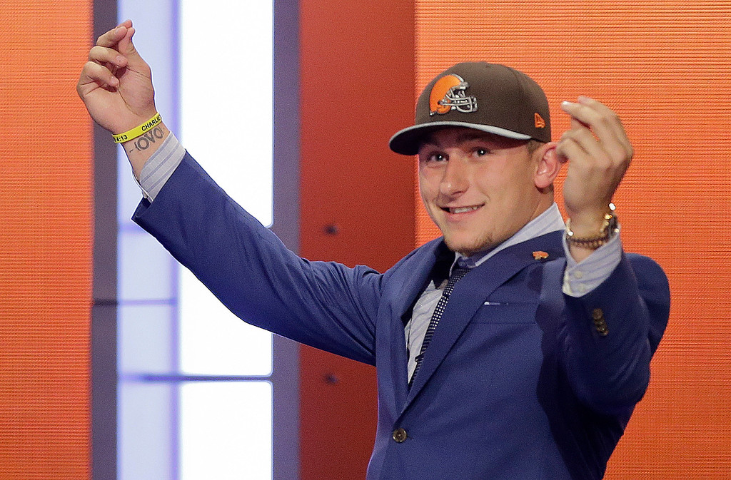 . FILE - In this May 8, 2014, file photo, Texas A&M quarterback Johnny Manziel reacts after being selected by the Cleveland Browns as the 22nd pick during the first round of the NFL Draft in New York. The Browns indicated Tuesday, Feb. 2, 2016, that they�ve finally had enough of Manziel�s bad-boy behavior and intend to release the quarterback in March when the league begins its next calendar year. (AP Photo/Frank Franklin II, File)