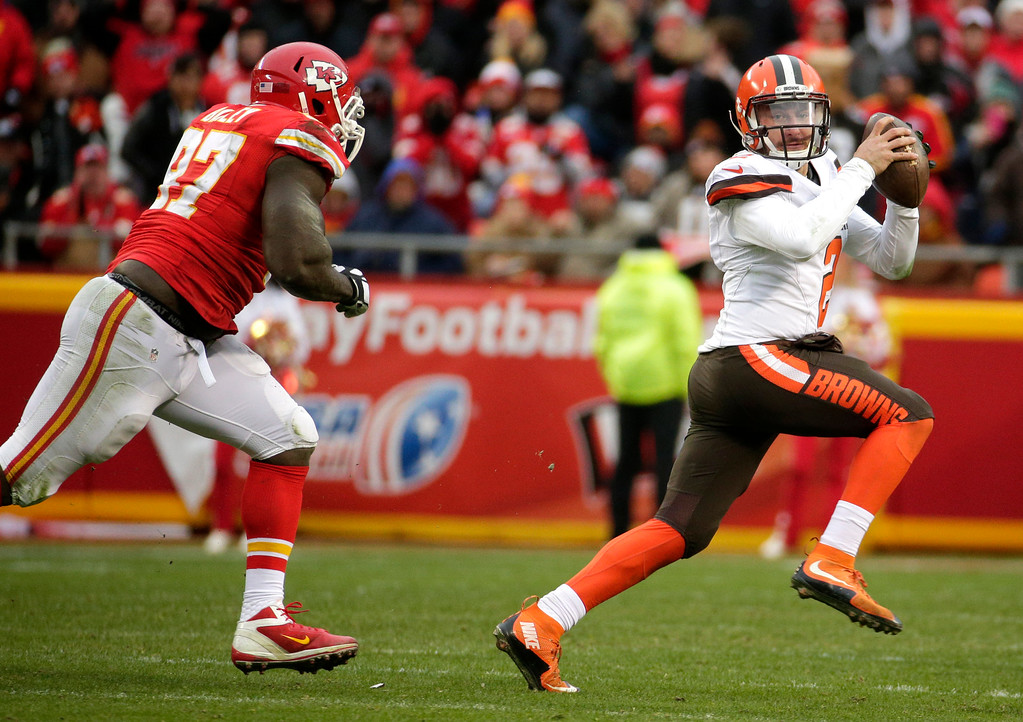 . Cleveland Browns quarterback Johnny Manziel, right, runs away from Kansas City Chiefs defensive end Allen Bailey (97) during the second half of an NFL football game in Kansas City, Mo., Sunday, Dec. 27, 2015. (AP Photo/Charlie Riedel)