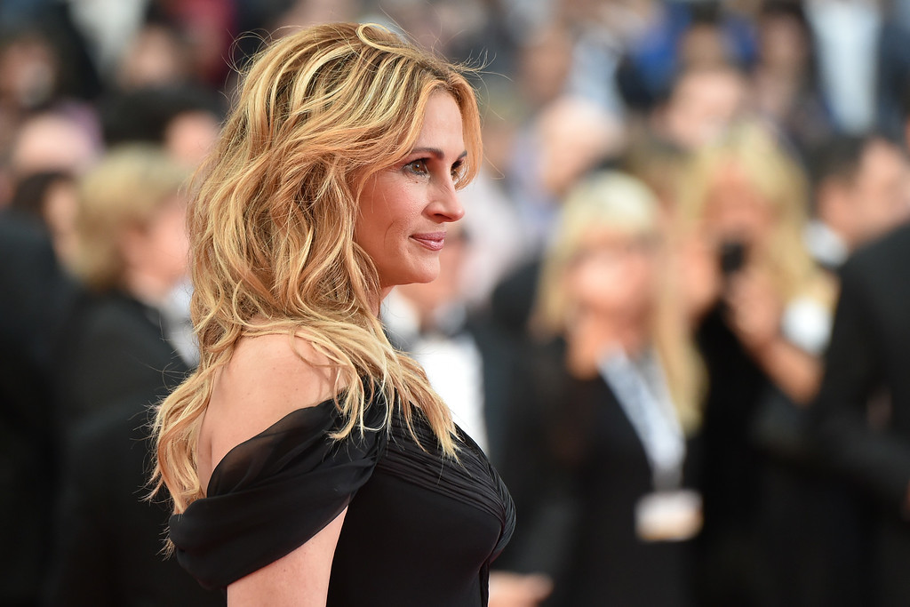 ". US actress Julia Roberts poses on May 12, 2016 as she arrives for the screening of the film ""Money Monster\"" at the 69th Cannes Film Festival in Cannes, southern France.  Roberts is more than just a \""Pretty Woman.\"" People magazine has named her the \""World\'s Most Beautiful Woman\"" announced Wednesday, April 19, 2017. (ALBERTO PIZZOLI/AFP/Getty Images)"