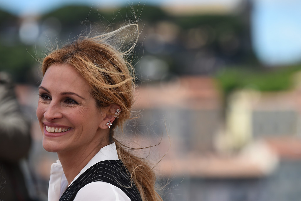". US actress Julia Roberts smiles on May 12, 2016 during a photocall for the film ""Money Monster\"" at the 69th Cannes Film Festival in Cannes, southern France.  ( ANNE-CHRISTINE POUJOULAT/AFP/Getty Images)"