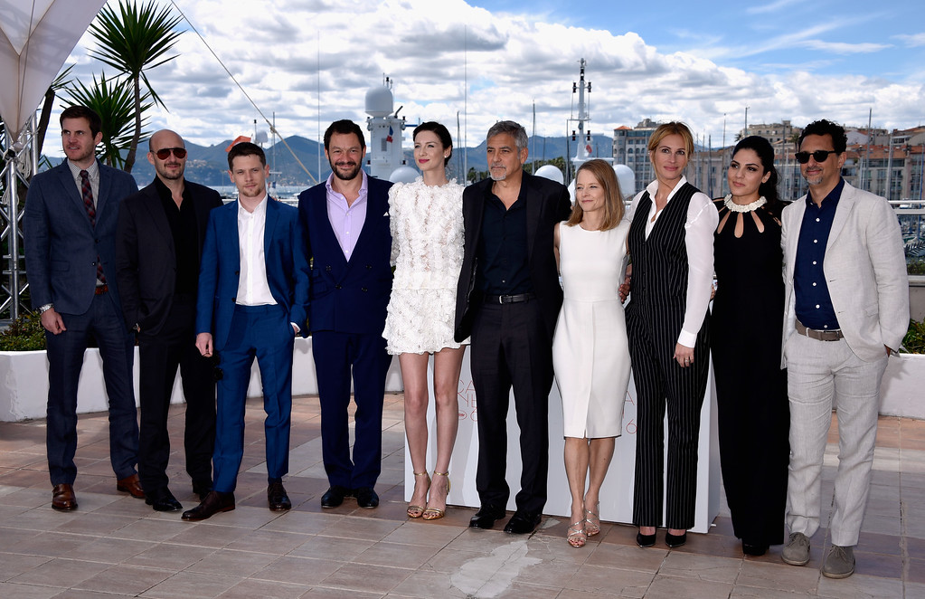 ". CANNES, FRANCE - MAY 12:  (L-R) Screenwriter Jamie Linden, producer Daniel Dubiecki, actors Jack O\'Connell, Dominic West, Caitriona Balfe, George Clooney, director Jodie Foster, actor Julia Roberts and producers Lara Alameddine and Grant Heslov attend the ""Money Monster\"" photocall during the 69th annual Cannes Film Festival at the Palais des Festivals on May 12, 2016 in Cannes, France.  (Photo by Clemens Bilan/Getty Images)"