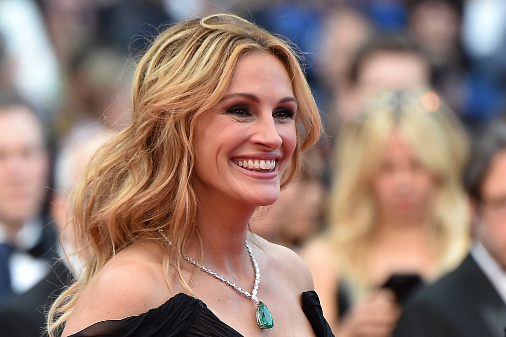 ". File - US actress Julia Roberts smiles on May 12, 2016 as she arrives for the screening of the film ""Money Monster\"" at the 69th Cannes Film Festival in Cannes, southern France.  Roberts is more than just a \""Pretty Woman.\"" People magazine has named her the \""World\'s Most Beautiful Woman\"" announced Wednesday, April 19, 2017. (ALBERTO PIZZOLI/AFP/Getty Images)"