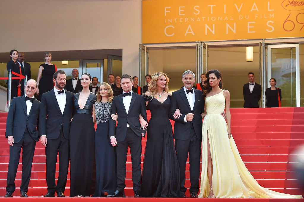 ". (From 2ndL) British actor Dominic West, Irish actress Caitriona Balfe US director Jodie Foster, British actor Jack O\'Connell, US actress Julia Roberts, US actor George Clooney and British-Lebanese lawyer Amal Clooney pose on May 12, 2016 with the President of the Cannes Film Festival Pierre Lescure (L) as they arrive for the screening of the film ""Money Monster\"" at the 69th Cannes Film Festival in Cannes, southern France.  (LOIC VENANCE/AFP/Getty Images)"
