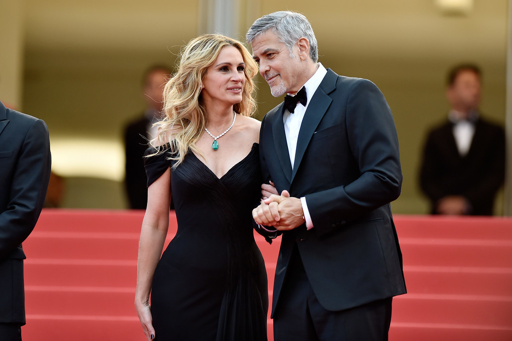 ". File - Actors Julia Roberts, and George Clooney attend the ""Money Monster\"" premiere during the 69th annual Cannes Film Festival at the Palais des Festivals on May 12, 2016 in Cannes, France.  Roberts is more than just a \""Pretty Woman.\"" People magazine has named her the \""World\'s Most Beautiful Woman\"" announced Wednesday, April 19, 2017. (Photo by Pascal Le Segretain/Getty Images)"