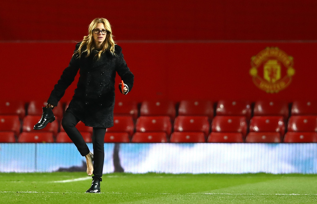 ". File - Actress Julia Roberts takes off her shoe on the pitch after the Premier League match between Manchester United and West Ham United at Old Trafford on November 27, 2016 in Manchester, England. Roberts is more than just a ""Pretty Woman.\"" People magazine has named her the \""World\'s Most Beautiful Woman\"" announced Wednesday, April 19, 2017. (Photo by Clive Brunskill/Getty Images)"