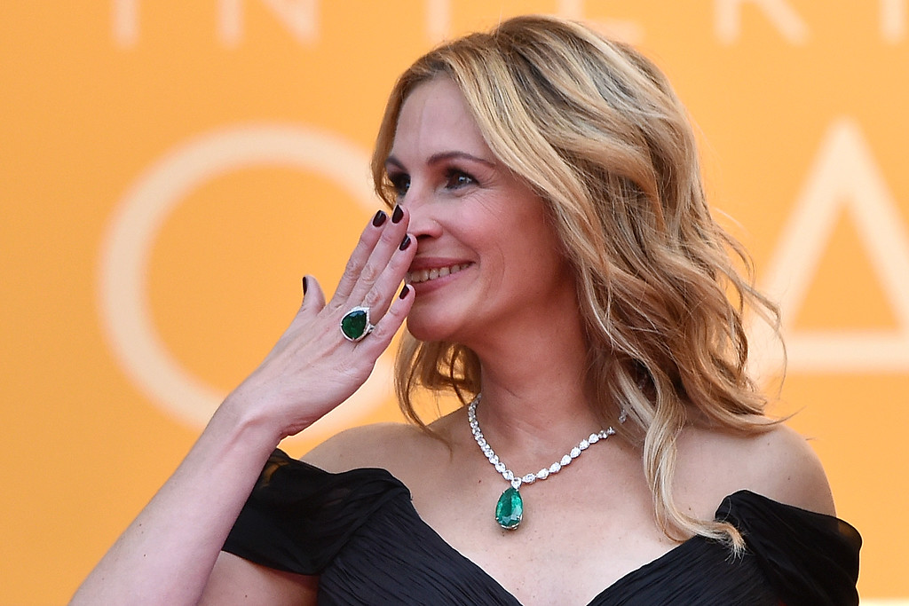 ". US actress Julia Roberts reacts on May 12, 2016 as she arrives for the screening of the film ""Money Monster\"" at the 69th Cannes Film Festival in Cannes, southern France.  (ALBERTO PIZZOLI/AFP/Getty Images)"