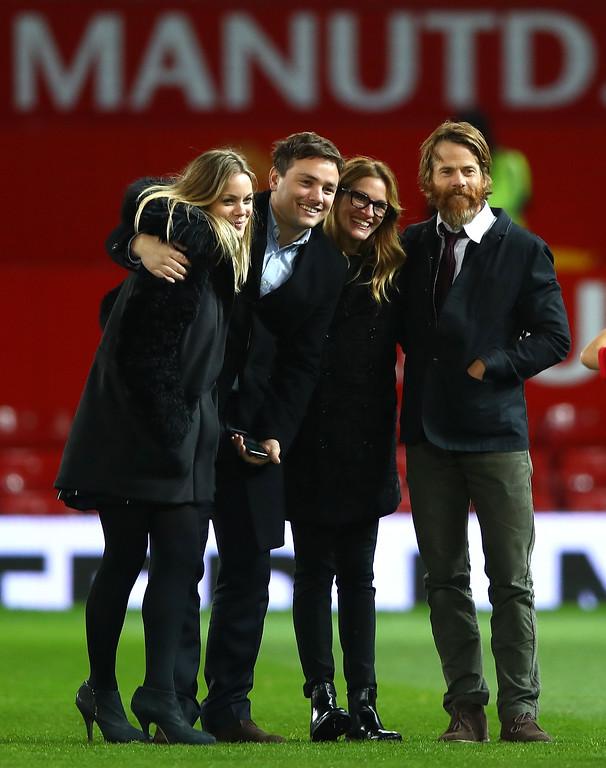. MANCHESTER, ENGLAND - NOVEMBER 27:  Actress Julia Roberts (2ndR) and husband Danny Moder (R) pose on the pitch after the Premier League match between Manchester United and West Ham United at Old Trafford on November 27, 2016 in Manchester, England.  (Photo by Clive Brunskill/Getty Images)