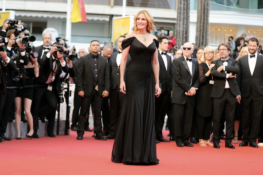 ". US actress Julia Roberts poses on May 12, 2016 as she arrives for the screening of the film ""Money Monster\"" at the 69th Cannes Film Festival in Cannes, southern France.  Roberts is more than just a \""Pretty Woman.\"" People magazine has named her the \""World\'s Most Beautiful Woman\"" announced Wednesday, April 19, 2017. (VALERY HACHE/AFP/Getty Images)"