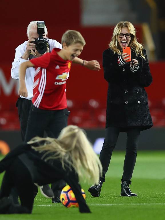 . MANCHESTER, ENGLAND - NOVEMBER 27:  Actress Julia Roberts takes photos of her children on the pitch after the Premier League match between  Manchester United and West Ham United at Old Trafford on November 27, 2016 in Manchester, England.  (Photo by Clive Brunskill/Getty Images)