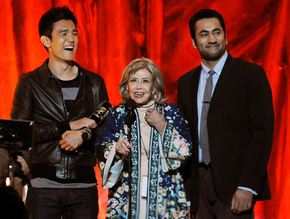 . Actors John Cho, left, and Kal Penn, right, flank voice artist June Foray as she accepts the Comic-Con Icon award at the 2011 Scream Awards, Saturday, Oct. 15, 2011, in Los Angeles. (AP Photo/Chris Pizzello)