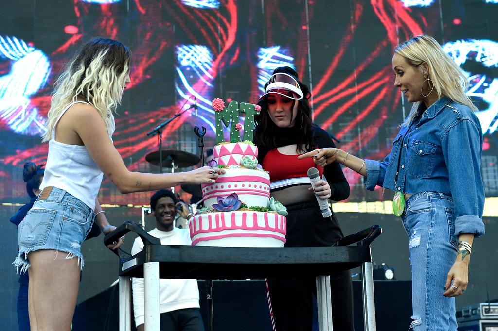. Miley Cyrus, from left, and her sister Noah Cyrus present a birthday cake to their mother Tish Cyrus at Wango Tango at StubHub Center on Saturday, May 13, 2017, in Carson, Calif. (Photo by Chris Pizzello/Invision/AP)