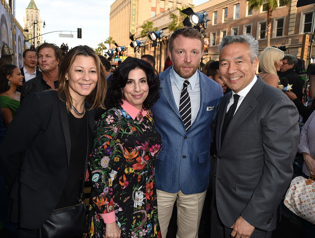 ". HOLLYWOOD, CA - MAY 08:  (L-R) President, International Distribution and Growth Initiatives, Warner Bros. Pictures Veronika Kwan Vandenberg, President, Worldwide Marketing and Distribution for Warner Bros. Pictures Sue Kroll, director Guy Ritchie, and Chairman and CEO of Warner Bros. Entertainment Kevin Tsujihara attend the premiere of Warner Bros. Pictures\' ""King Arthur: Legend Of The Sword\"" at TCL Chinese Theatre on May 8, 2017 in Hollywood, California.  (Photo by Kevin Winter/Getty Images)"