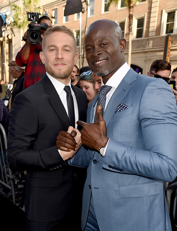 ". HOLLYWOOD, CA - MAY 08:  Actors Charlie Hunnam (L) and Djimon Hounsou attend the premiere of Warner Bros. Pictures\' ""King Arthur: Legend Of The Sword\"" at TCL Chinese Theatre on May 8, 2017 in Hollywood, California.  (Photo by Kevin Winter/Getty Images)"