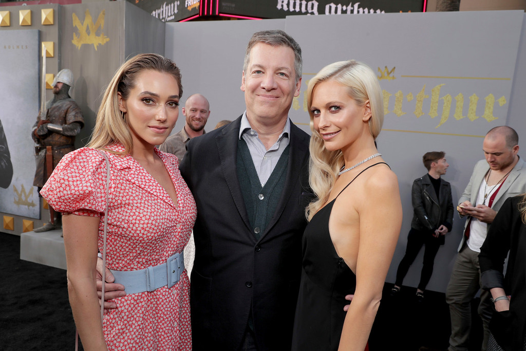 ". Jacqui Ainsley, Writer/Producer Lionel Wigram and Poppy Delevingne seen at Warner Bros. World Premiere of ""King Arthur: Legend of the Sword\"" at TCL Chinese Theatre on Monday, May 8, 2017, in Hollywood, CA. (Photo by Eric Charbonneau/Invision for Warner Bros./AP Images)"