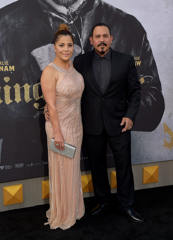 """. HOLLYWOOD, CA - MAY 08:  Actor Emilio Rivera (R) and Yadi Valerio Rivera attend the premiere of Warner Bros. Pictures\' \""""King Arthur: Legend Of The Sword\"""" at TCL Chinese Theatre on May 8, 2017 in Hollywood, California.  (Photo by Matt Winkelmeyer/Getty Images)"""