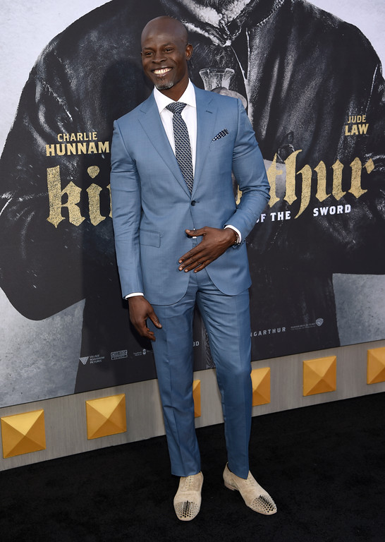 ". Djimon Hounsou arrives at the world premiere of ""King Arthur: Legend of the Sword\"" at the TCL Chinese Theatre on Monday, May 8, 2017, in Los Angeles. (Photo by Chris Pizzello/Invision/AP)"