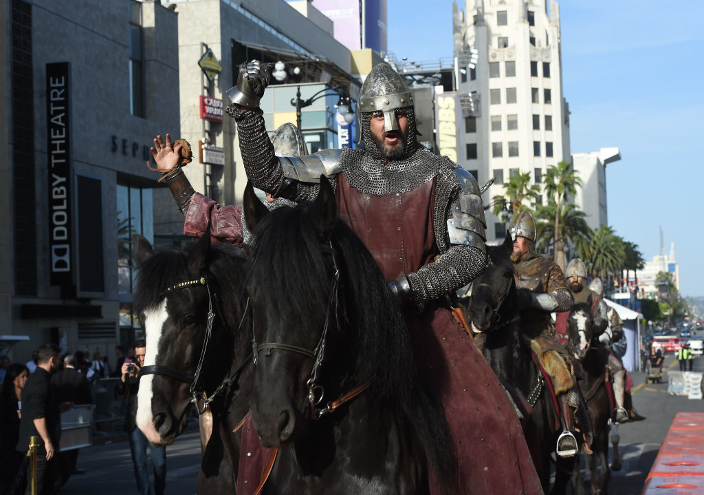 ". HOLLYWOOD, CA - MAY 08:  Actors on horses walk down Hollywood Boulevard during the premiere of Warner Bros. Pictures\' ""King Arthur: Legend Of The Sword\"" at TCL Chinese Theatre on May 8, 2017 in Hollywood, California.  (Photo by Kevin Winter/Getty Images)"