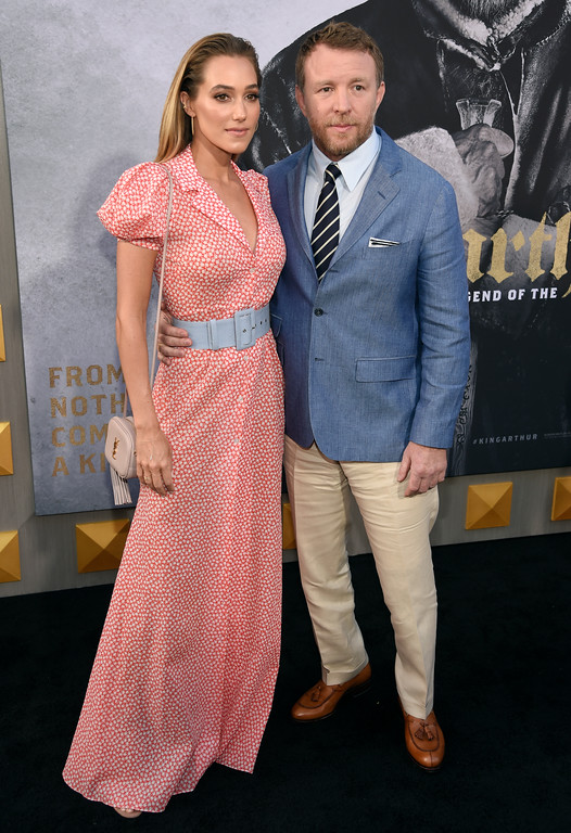 ". Jacqui Ainsley, left, and Guy Ritchie arrive at the world premiere of ""King Arthur: Legend of the Sword\"" at the TCL Chinese Theatre on Monday, May 8, 2017, in Los Angeles. (Photo by Chris Pizzello/Invision/AP)"